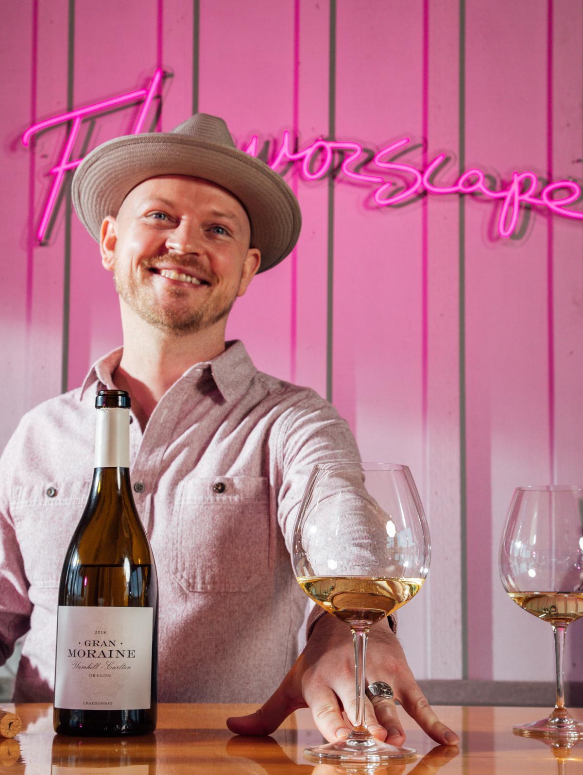 Man behind bar serving Gran Moraine white wine
