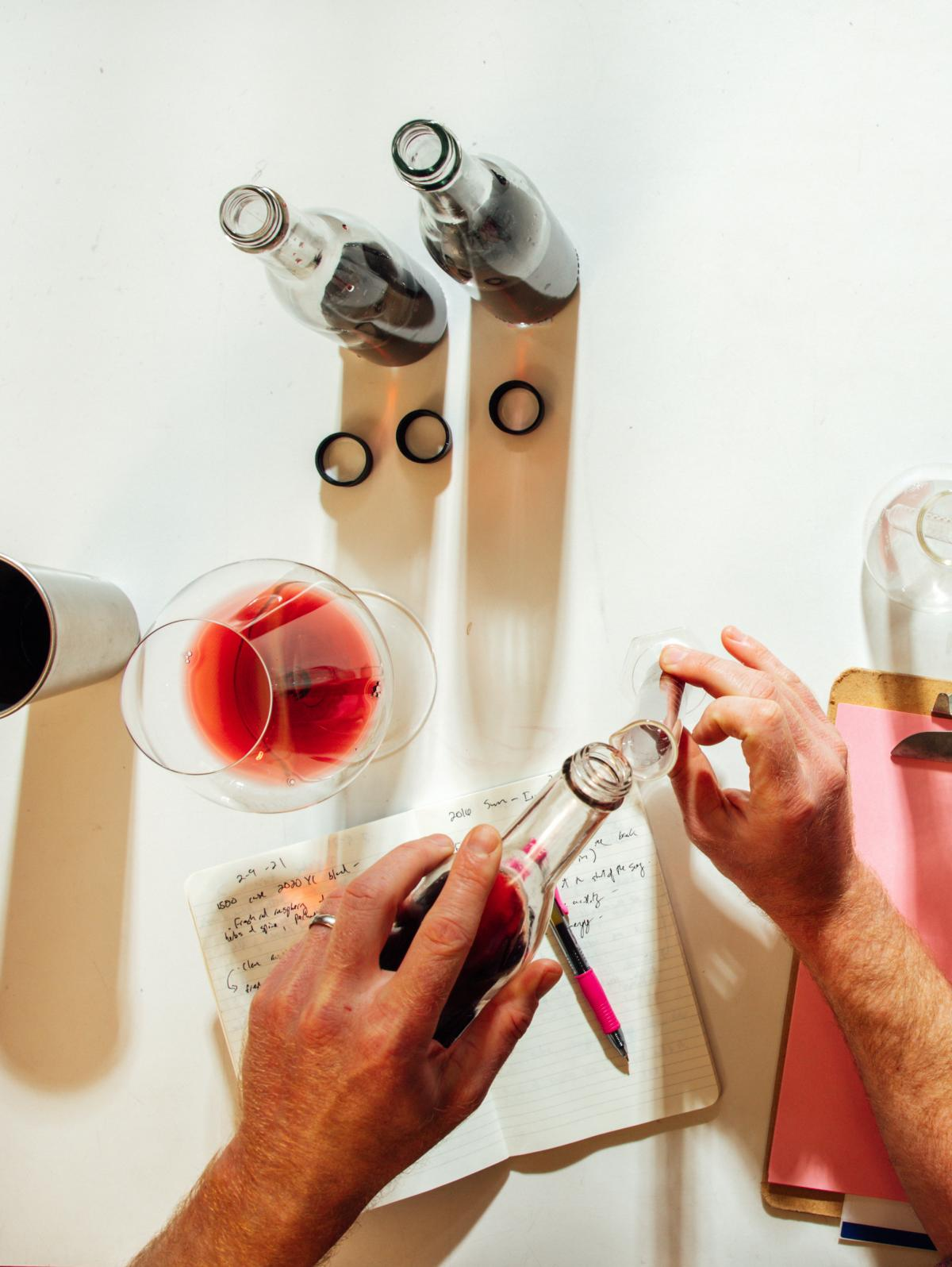 Overhead shot of a person blending wine in a wine lab