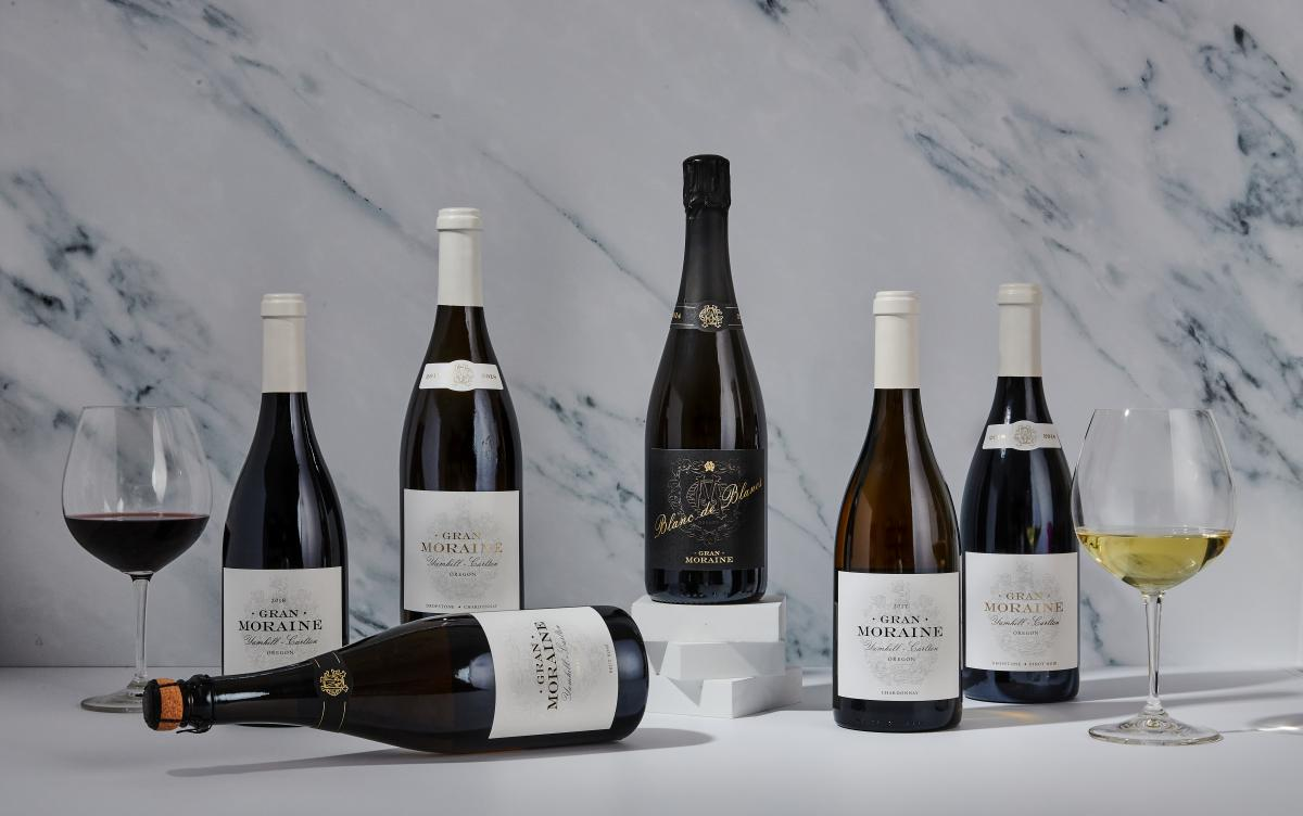 Several bottles of Gran Moraine wine against a marble backdrop