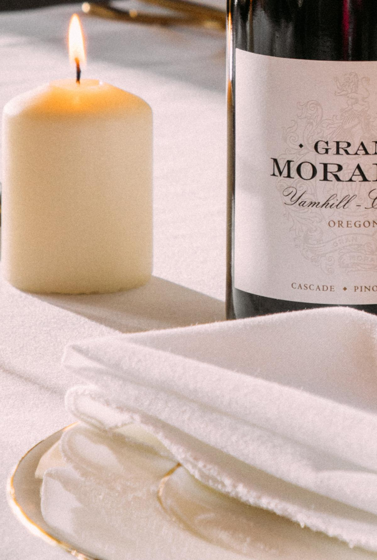 Bottle of Cascade Pinot Noir on a fancy table