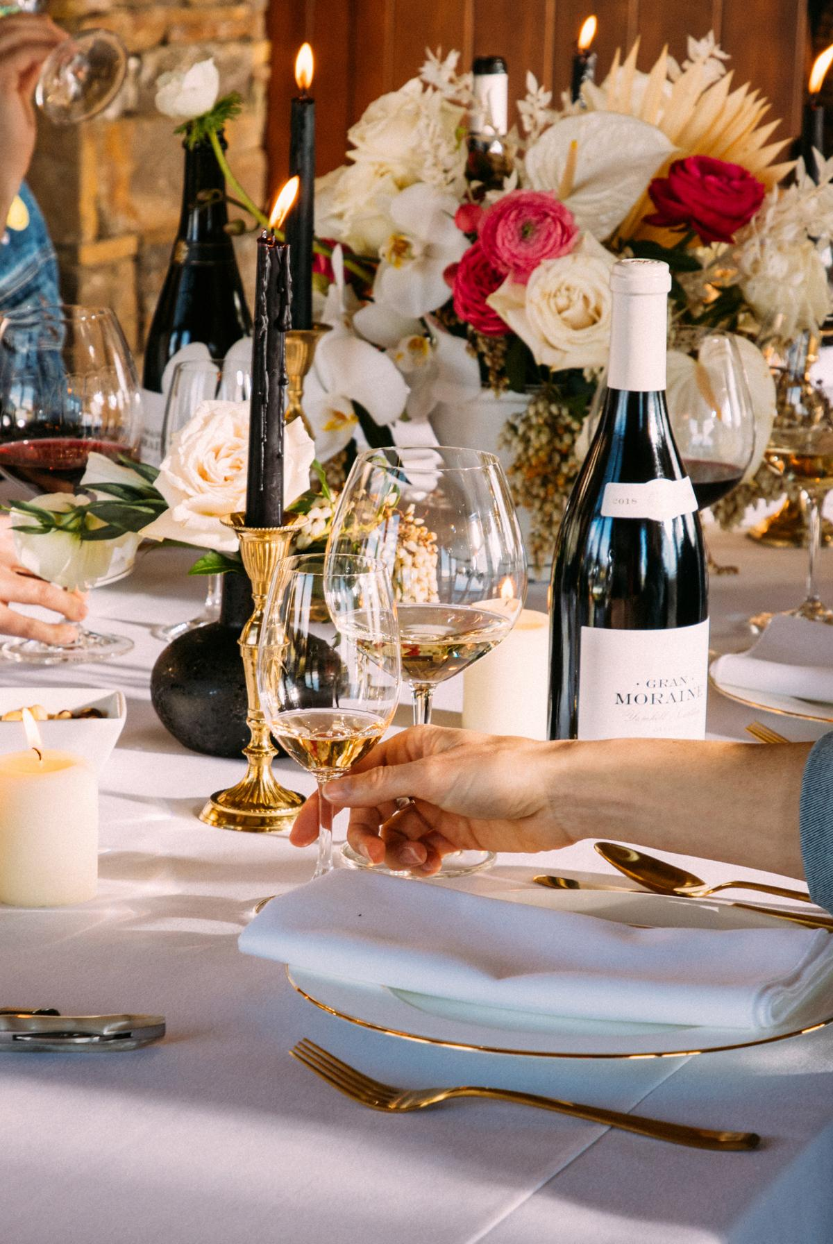 Table set with candles and Gran Moraine wines