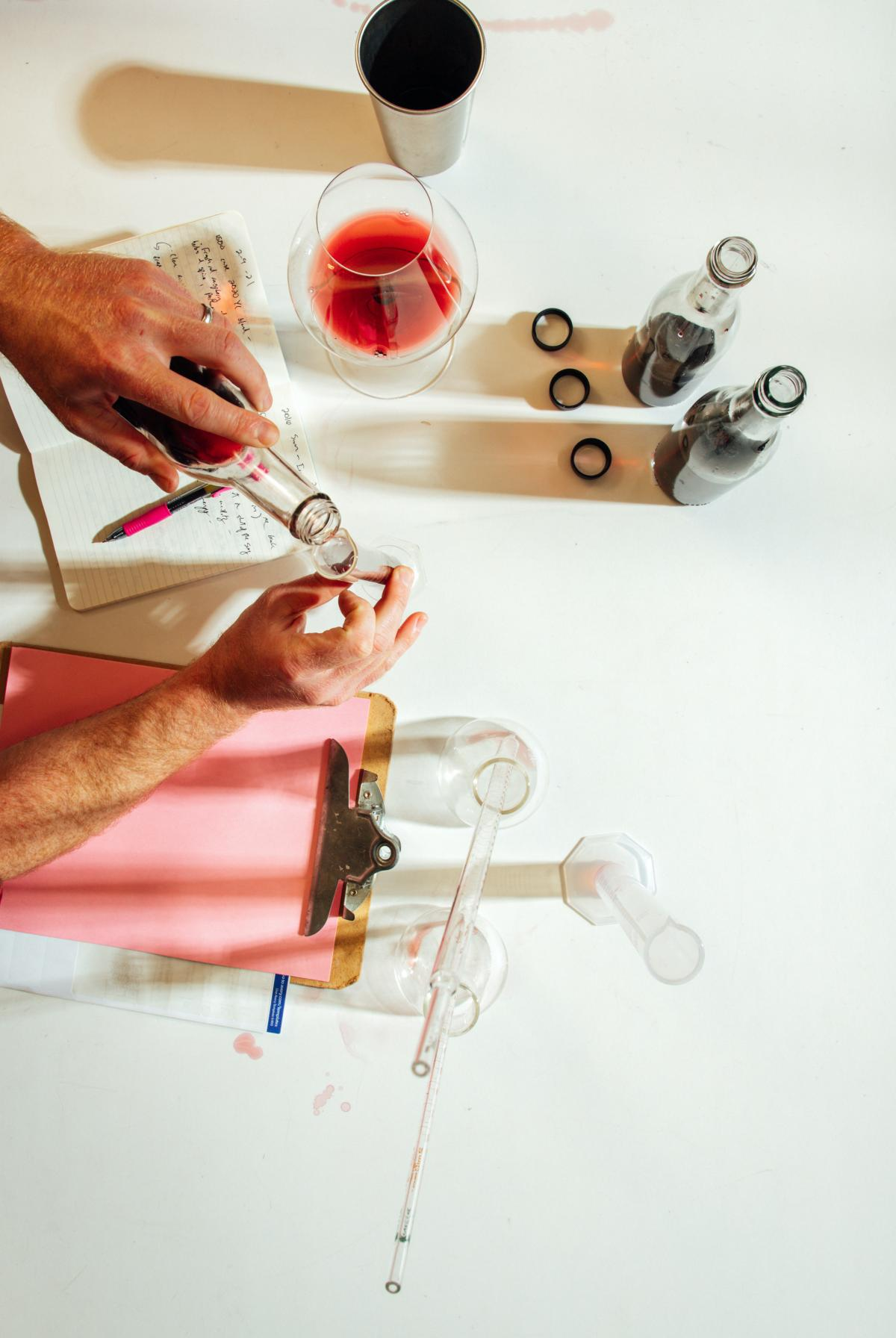 Overhead shot of a person blending wine in a lab