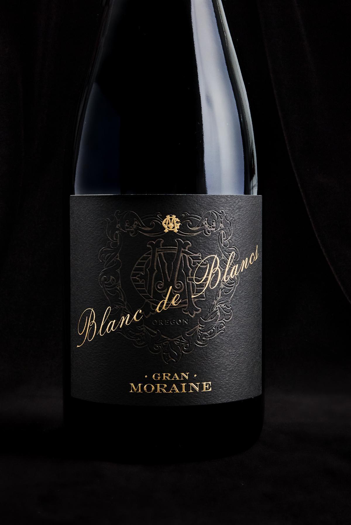 Blanc de Blanc bottle against a black background