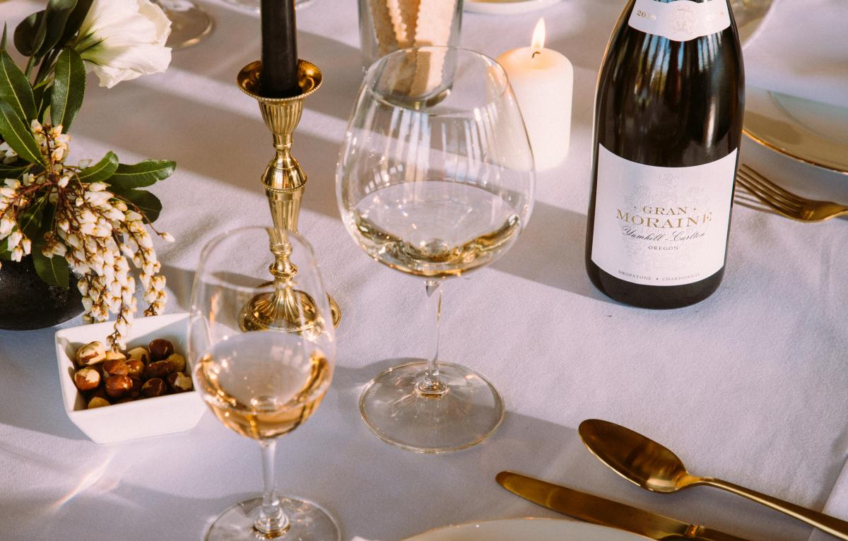Glasses of white wine on an elegently set table